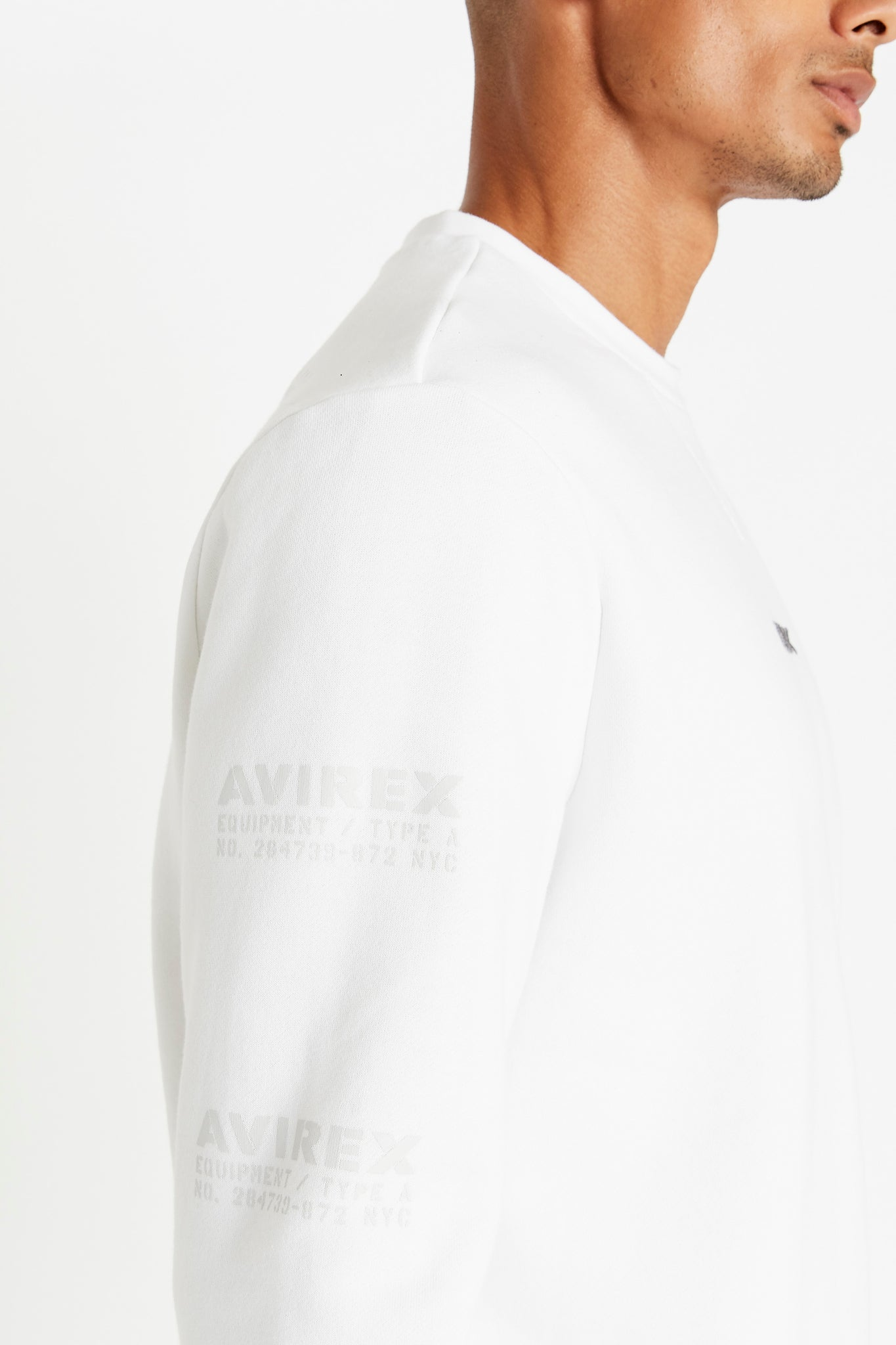 Detailed view of utility logo print on right sleeve