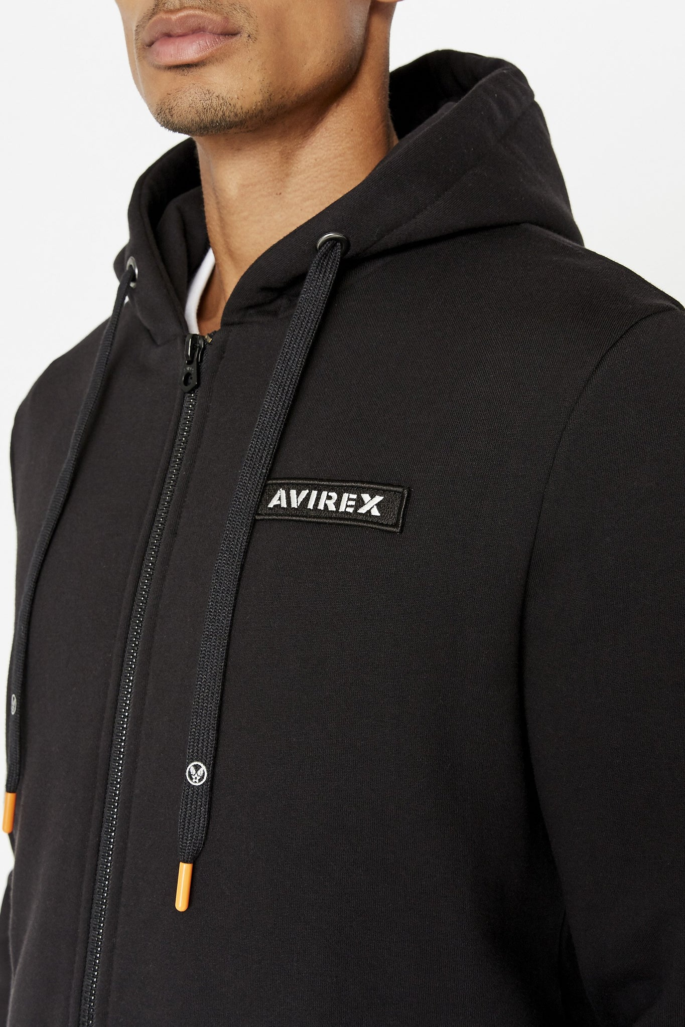 Detailed view of Avirex chest patch and branded draw cords