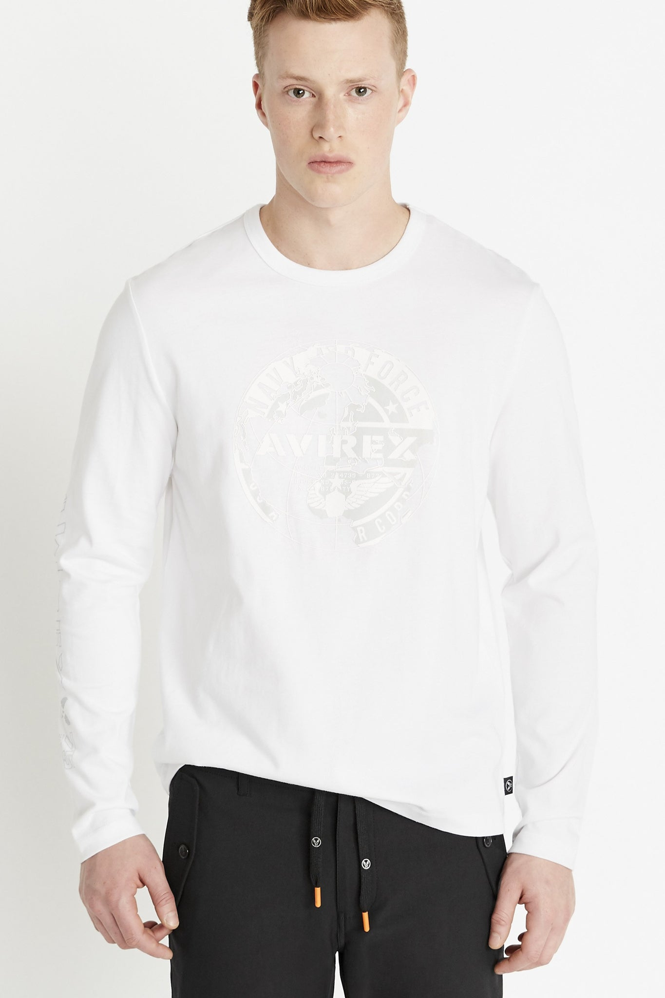 Men wearing a white long sleeve crew neck T-shirt with white round logo graphic print on chest