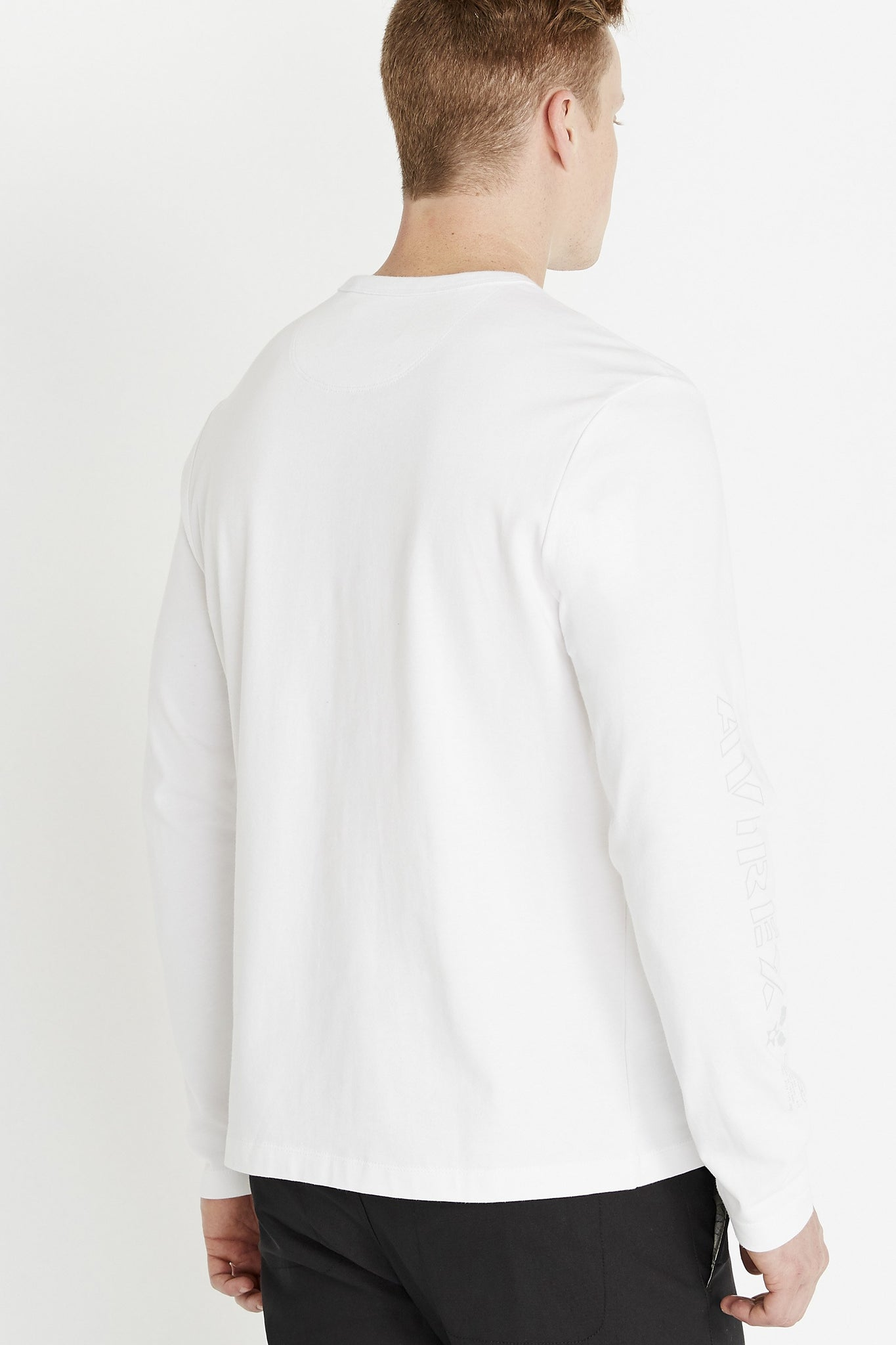 Back view of men wearing a white long sleeve crew neck T-shirt