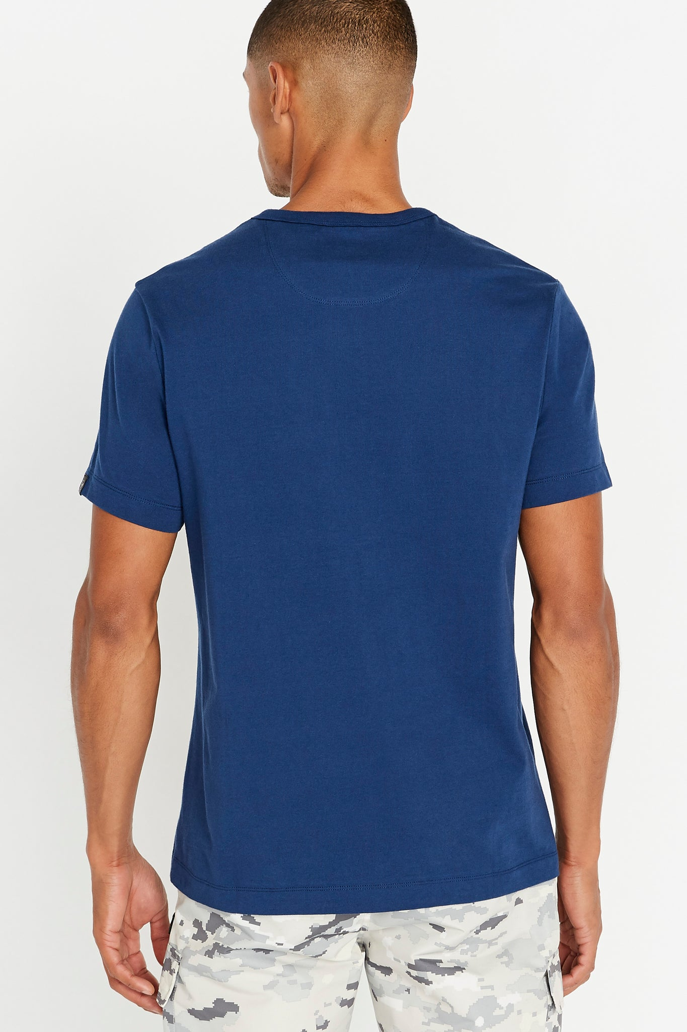 Back view of men wearing a blue short sleeve crew neck T-shirt