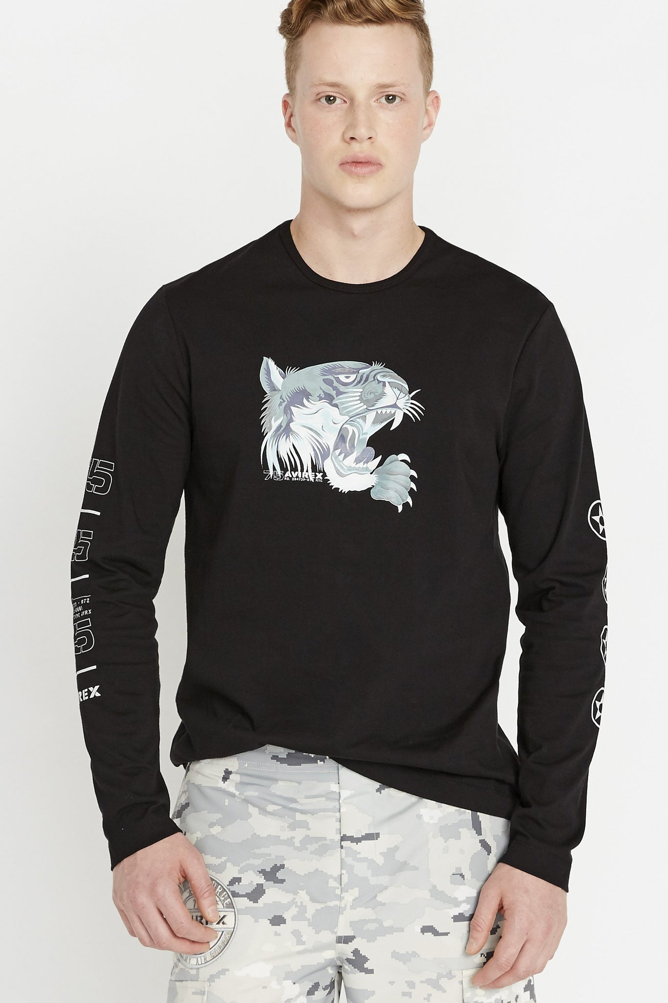 Men wearing a black long sleeve crew neck T-shirt with light grey tiger print on chest and label print on both sleeves