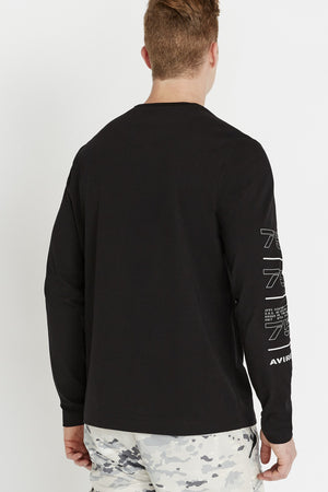 Back view of men wearing a black long sleeve crew neck T-shirt with label printed on sleeve