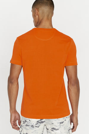 Back view of men wearing an orange short sleeve crew neck T-shirt
