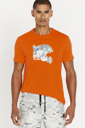 Men wearing an orange short sleeve crew neck T-shirt with light grey tiger print on chest