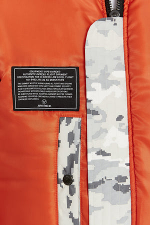 Detailed view of one patch and one pocket of reversed orange side