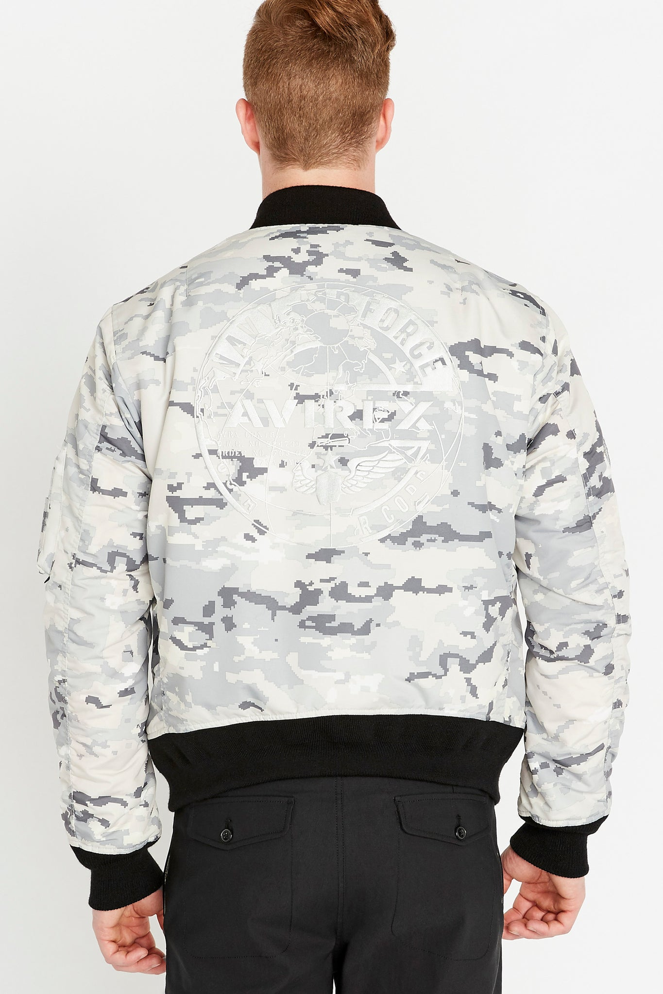 Back view of men wearing a snow camo printed polyester bomber jacket