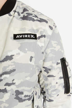 Detailed view of Avirex logo patch on the chest and one utility pocket on the left sleeve