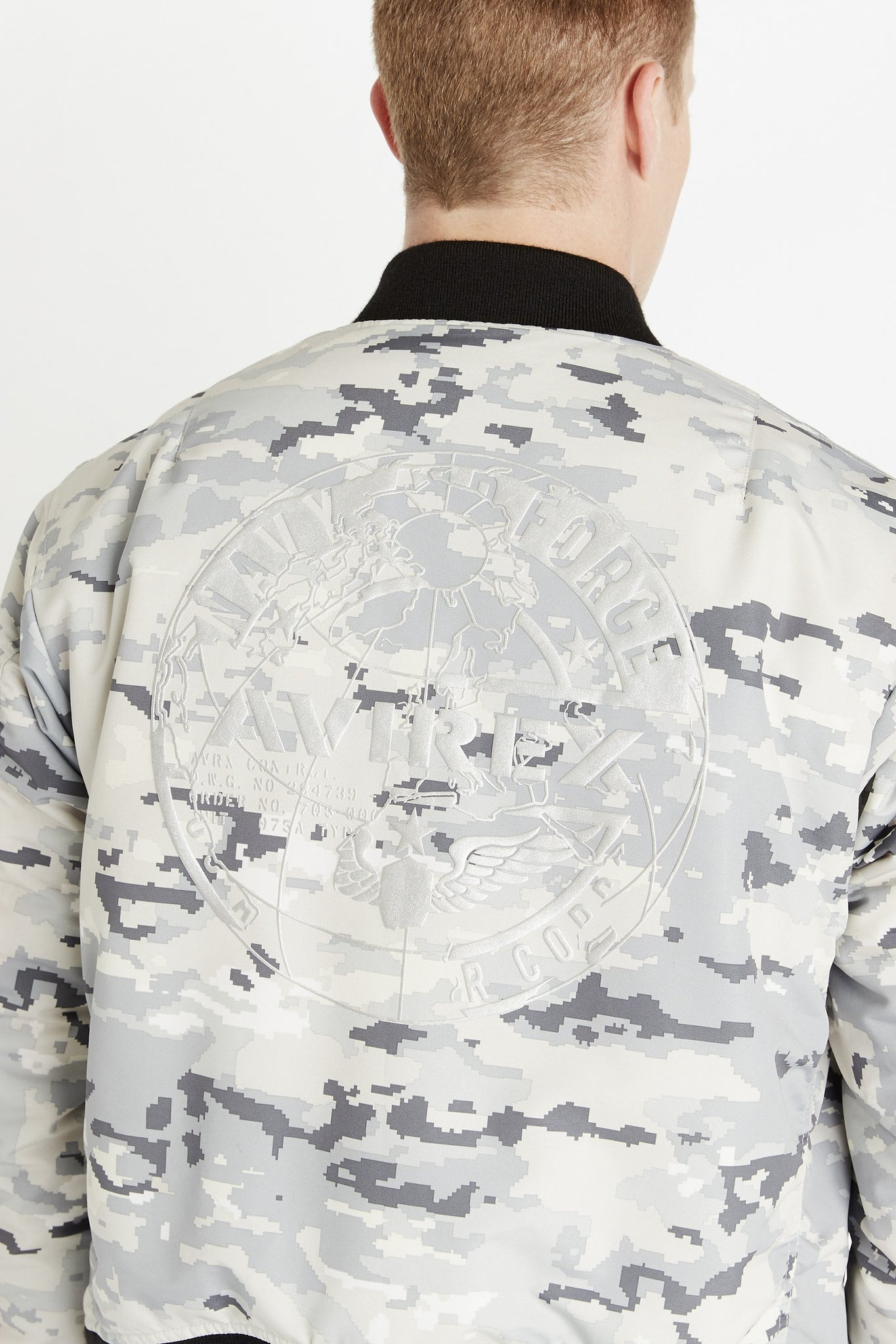 Detailed view of Avirex round print on the back in white color