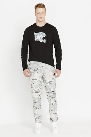 Full view of men wearing a digital snow camo print pants with side cargo pockets and black long sleeve crew neck sweater