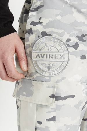Detailed view of round logo above right side cargo pocket