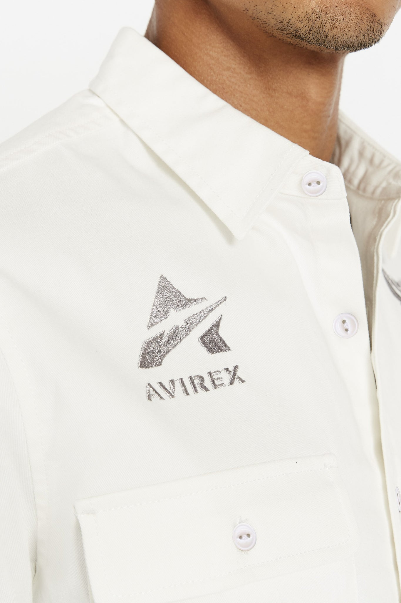 Detailed view of embroidery logo above pocket on right chest