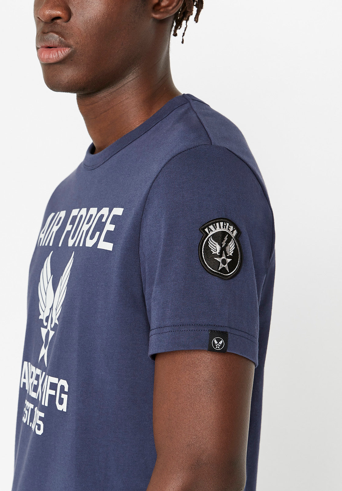 Side view of blue t-shirt with Avirex Wingstar patch on left shoulder