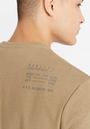 Detailed view of US Army registration plate in grey on beige sweater