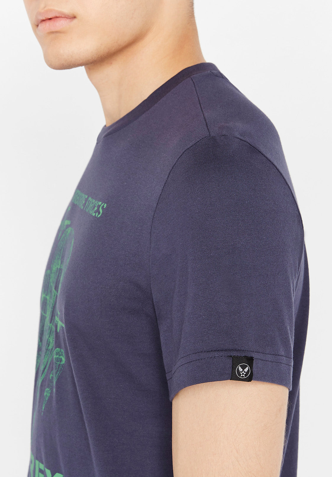 Detailed view of Avirex Wingstar label on blue t-shirt