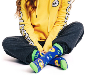 model in a hoodie wearing zodiac sign crew socks Capricorn from Tale of Socks