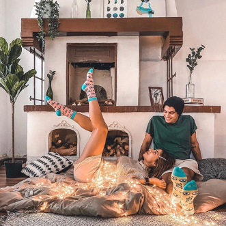 The lovely couple Timmy Mowafi and Farah Hosny wearing evil eye socks from Tale of Socks