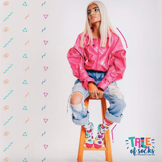 model wears socks from Tale of Socks - the Memphis geometric collection