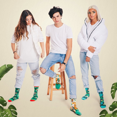 Models wearing crew socks jungle collection from Tale of Socks