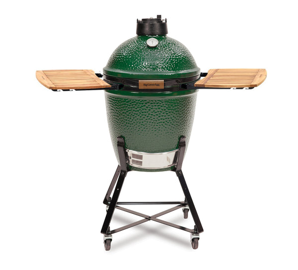 Big Green Medium Deluxe Bundle. Big Green Egg medium in next with acacia eggmate side tables on white background.