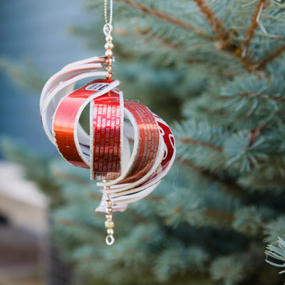 Recycled Soda Can Spiral Ornament Hanging on Tree