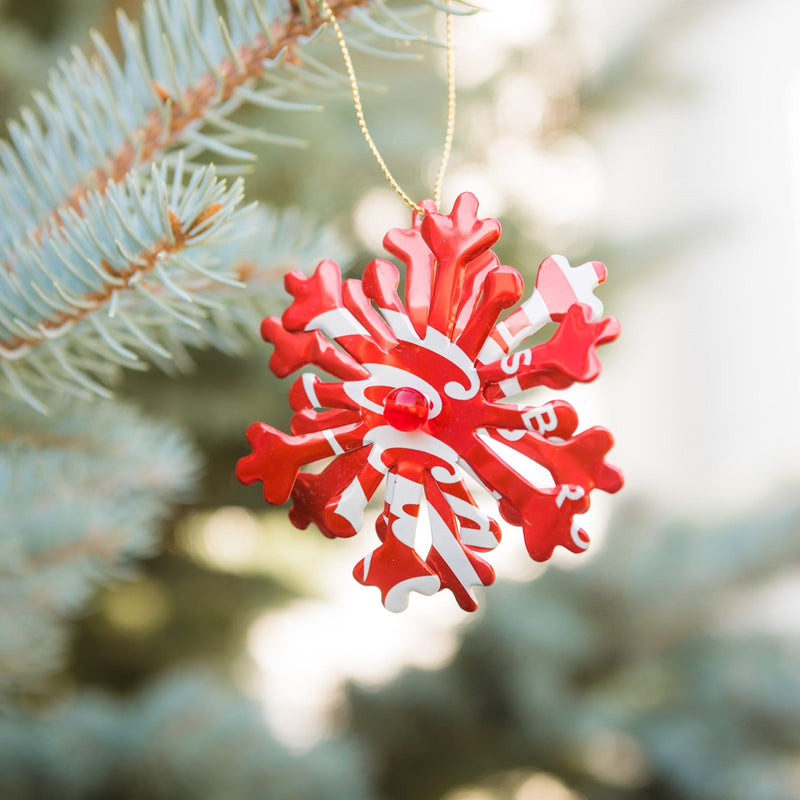Recycled Soda Can Snowflake Ornament Hanging on Tree