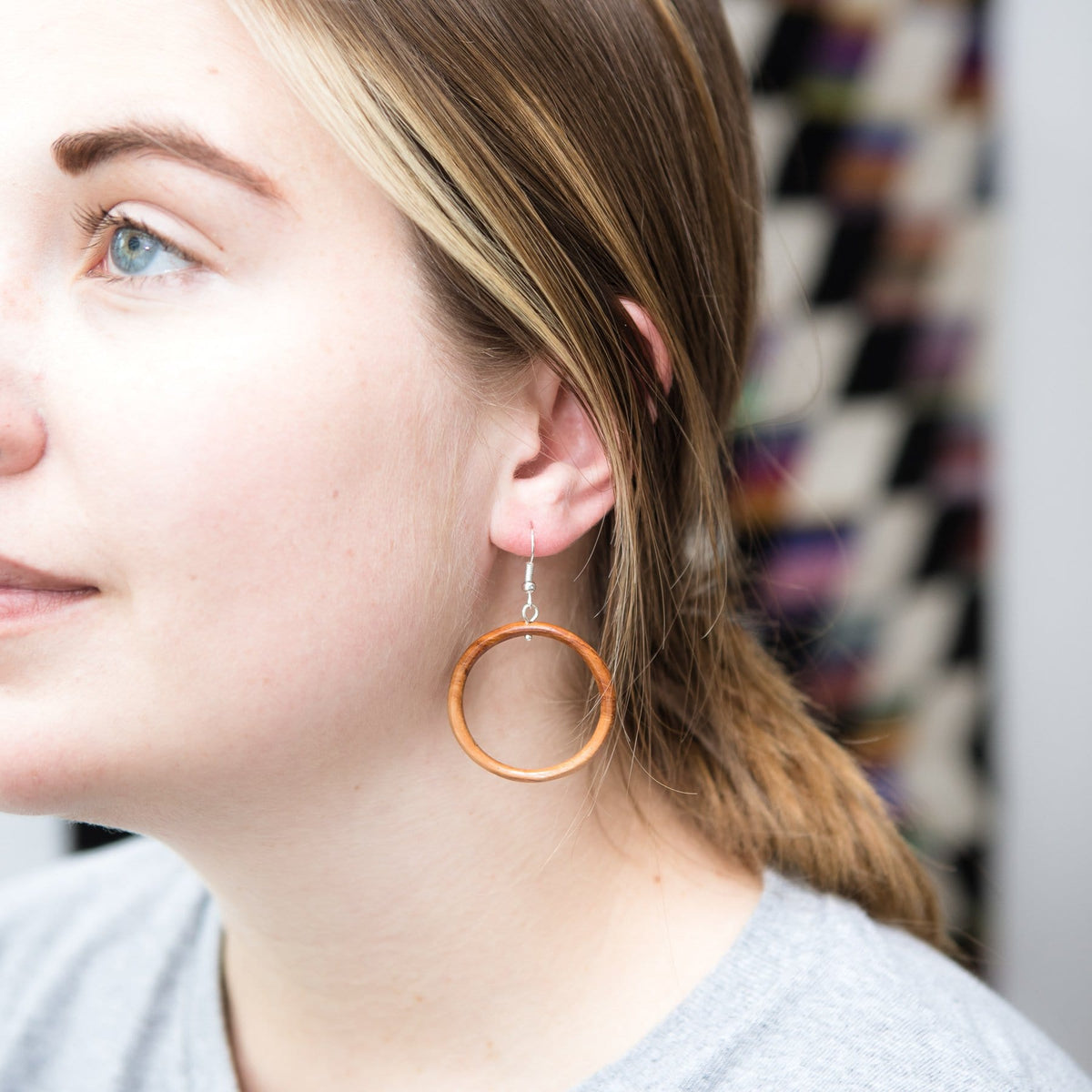 Model Wearing Fair Trade Wood Hoop Earrings