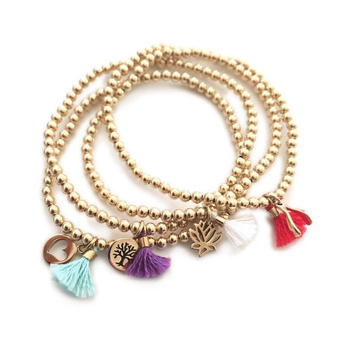 Gold and Tassle Bracelet with Charm