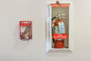 Fire Sprinkler Stopper Tool + Wall Mount Combo next to extinguisher