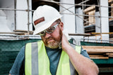 construction worker on a job site wiping neck with cleaning wipe