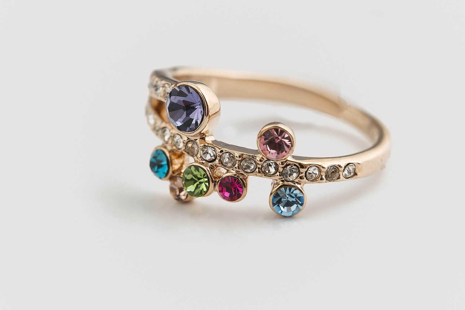 A gold ring with multicolored stones.