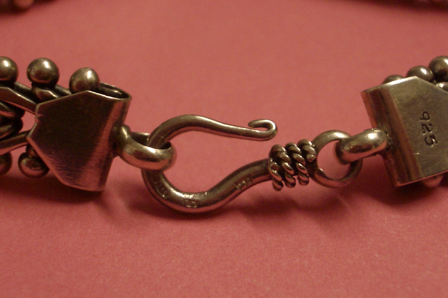 A 925 hallmark on the clasp of a bracelet indicates that it is likely sterling silver.