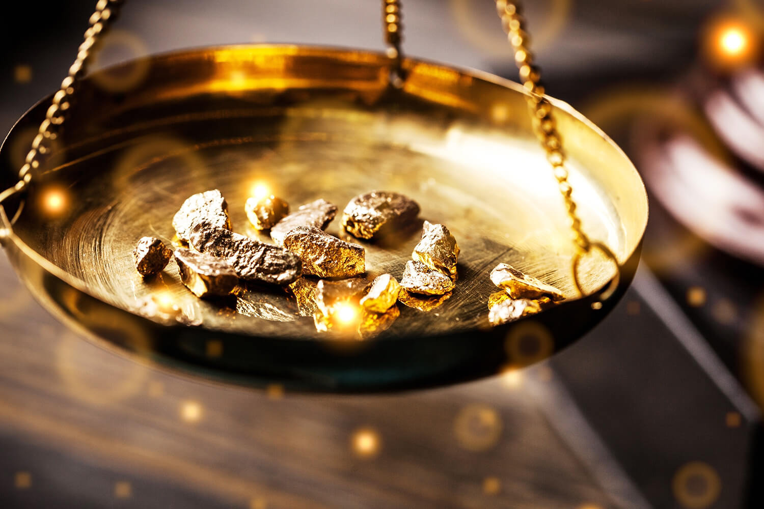 A scale weighing gold nuggets.