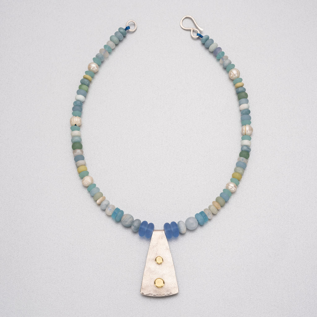 Semi-precious stones and silver pendant with 18ct gold