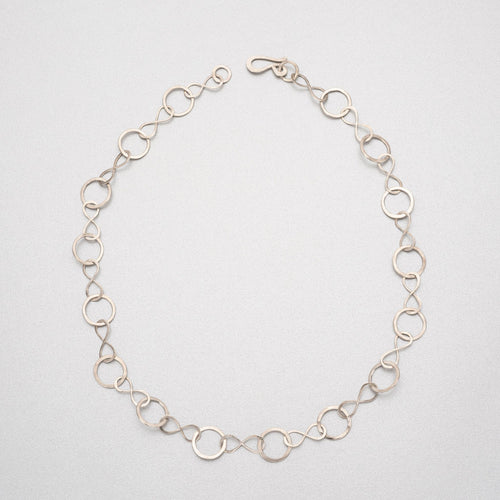Hand beaten silver chain with figure of eight and round links