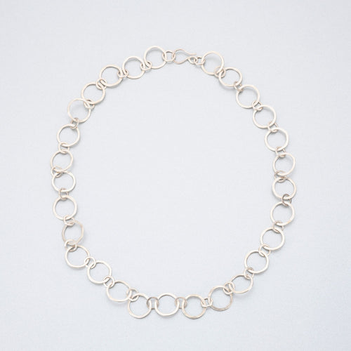 Hand beaten silver chain with round links