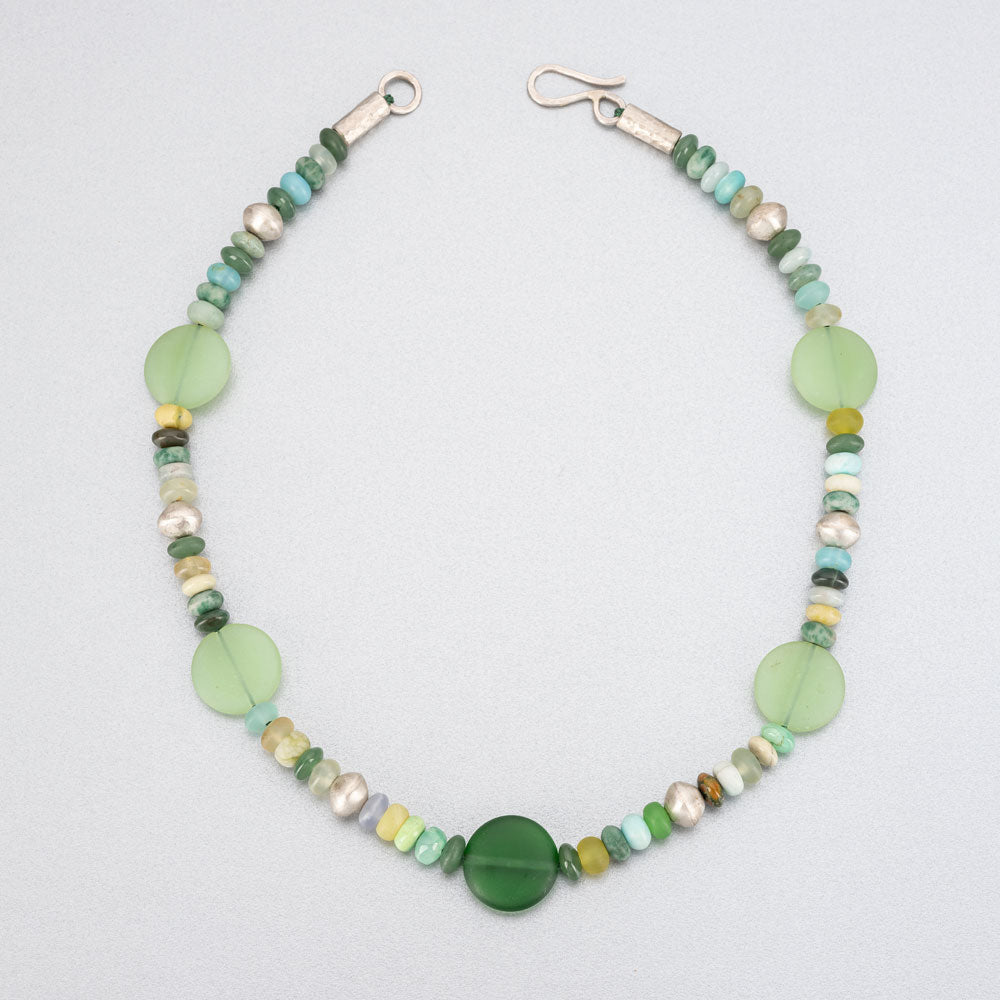 Beaded necklace with sea glass discs