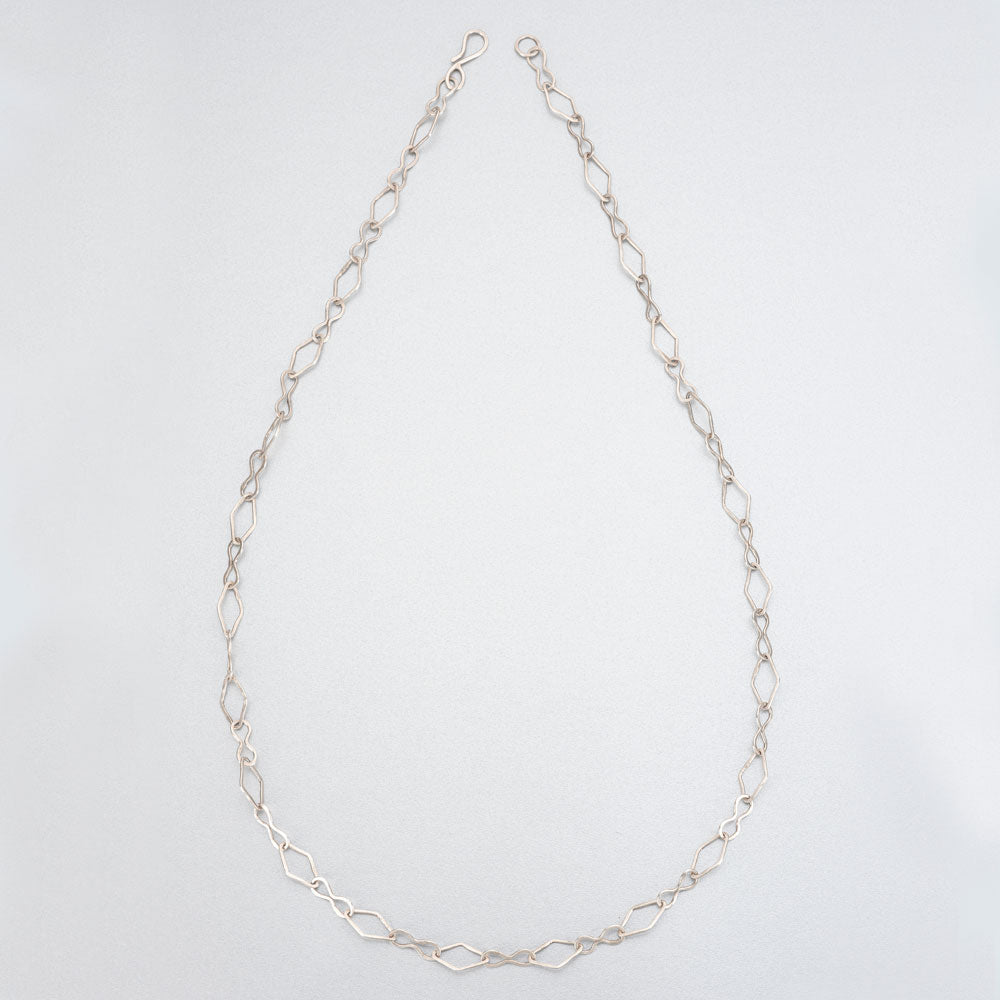 Hand beaten silver chain with diamond shaped links