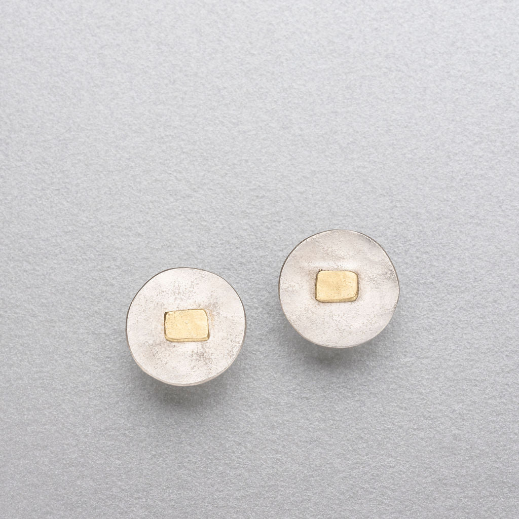 Silver studs with 18ct gold.