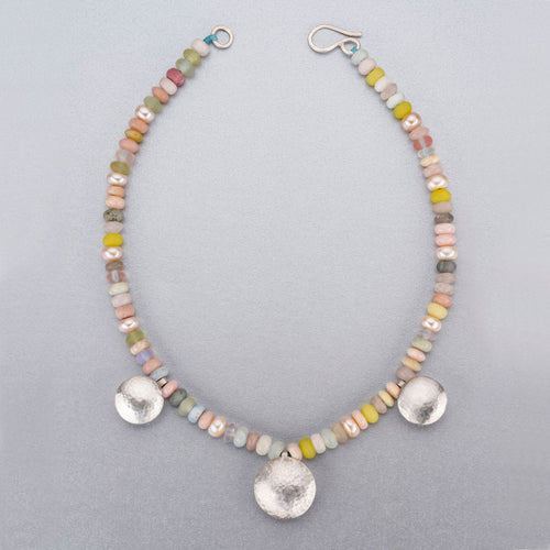 Beaded necklace with silver discs.