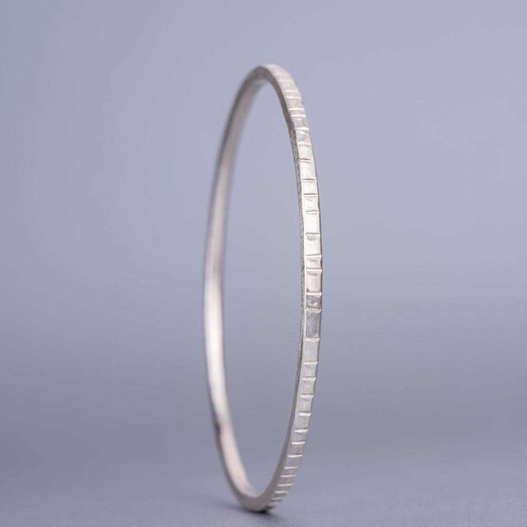 Hand beaten silver bangle with lines