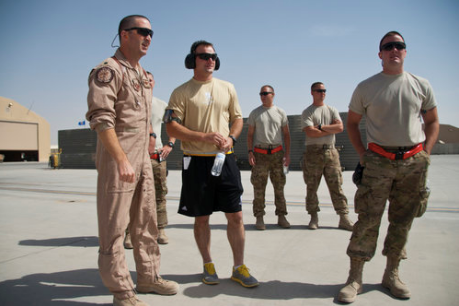 Eric Chandler (left) gives PFC Kyle Lynch (center), a Purple Heart recipient, a tour of the Kandahar, Air Base flight line in Afghanistan. Photo courtesy of SSgt. Chris Axelson.