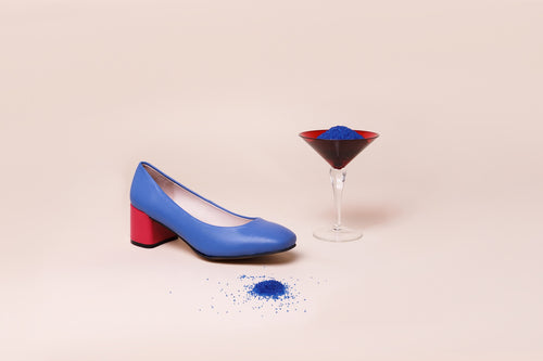 Blue leather pump with chunky fuchsia pink heel.