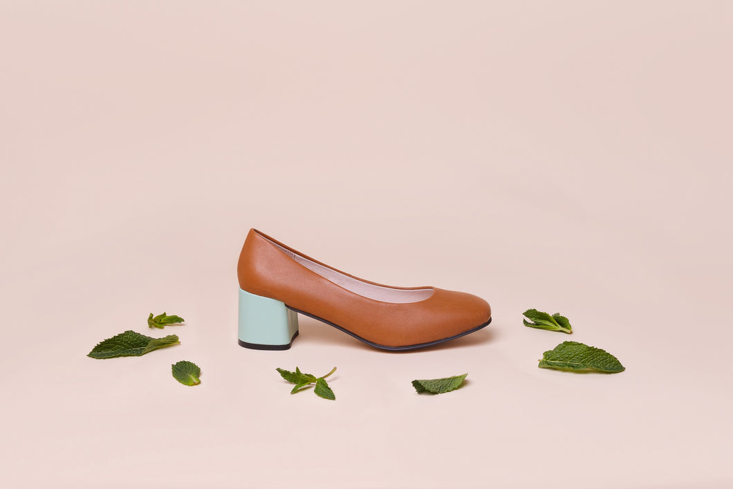 Tan leather pump with chunky mint green heel.