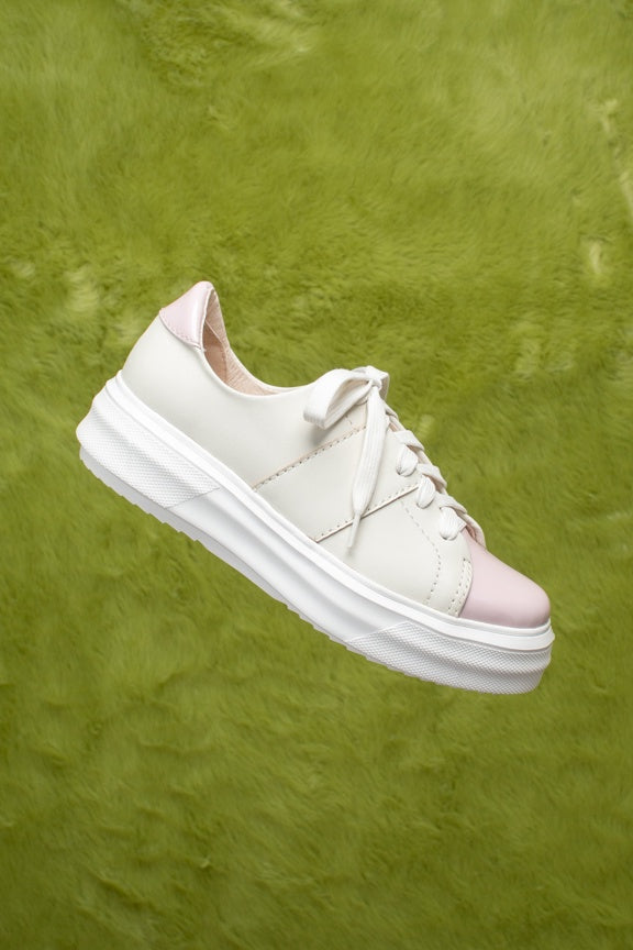 Cream leather and pale pink patent leather lace-up sneakers.