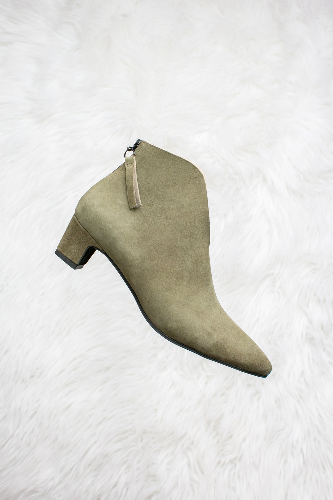 Olive green suede boots.