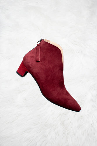 Burgundy suede boots.