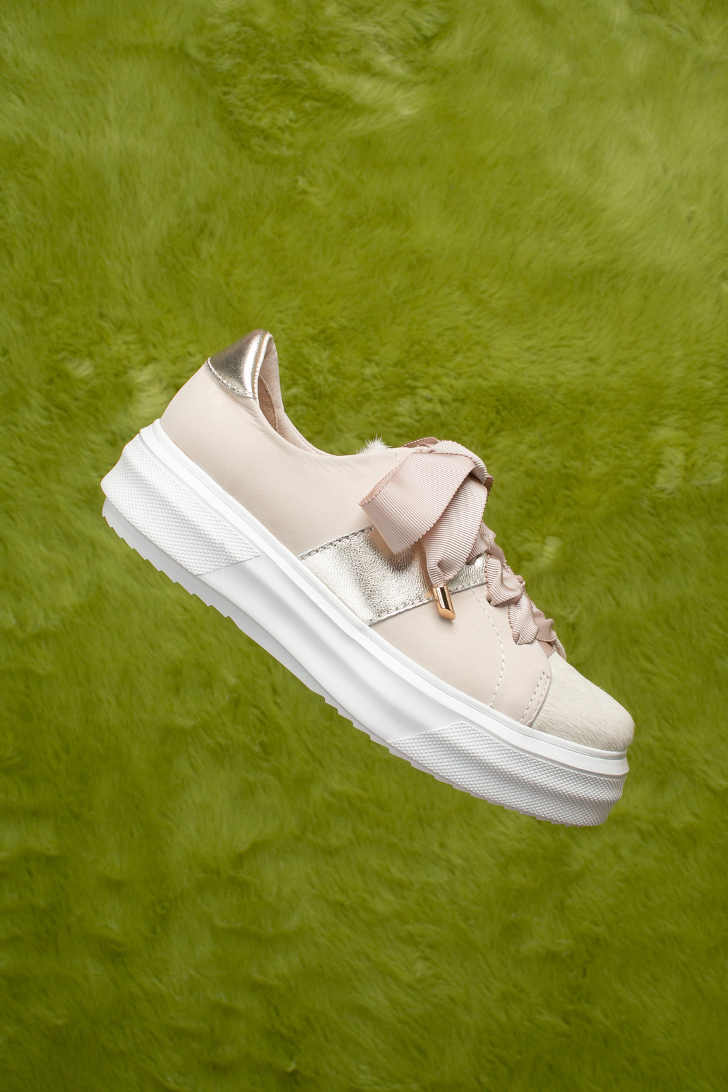 Beige pony hair leather lace-up sneaker with a light chunky white sole.