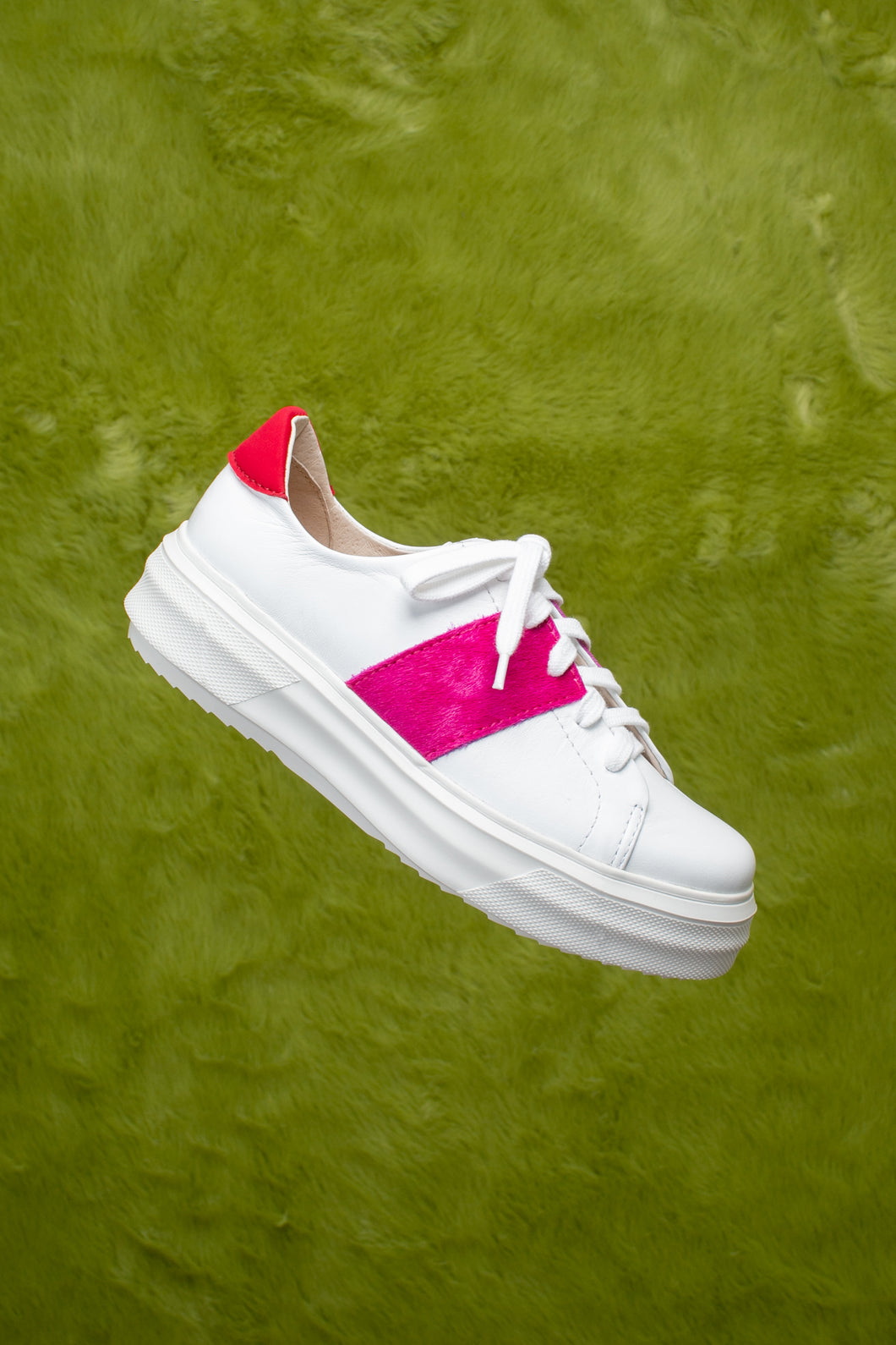 White leather lace up sneaker with fuchsia pink pony hair.