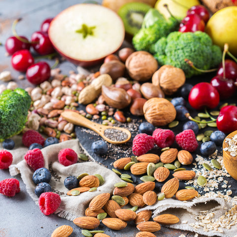 High-fiber foods including broccoli, walnuts, almonds, chia seeds, and berries